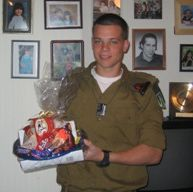 A soldier receiving a Purim Basket in 2009