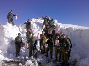 IDF Soldiers in front of large mound of snow