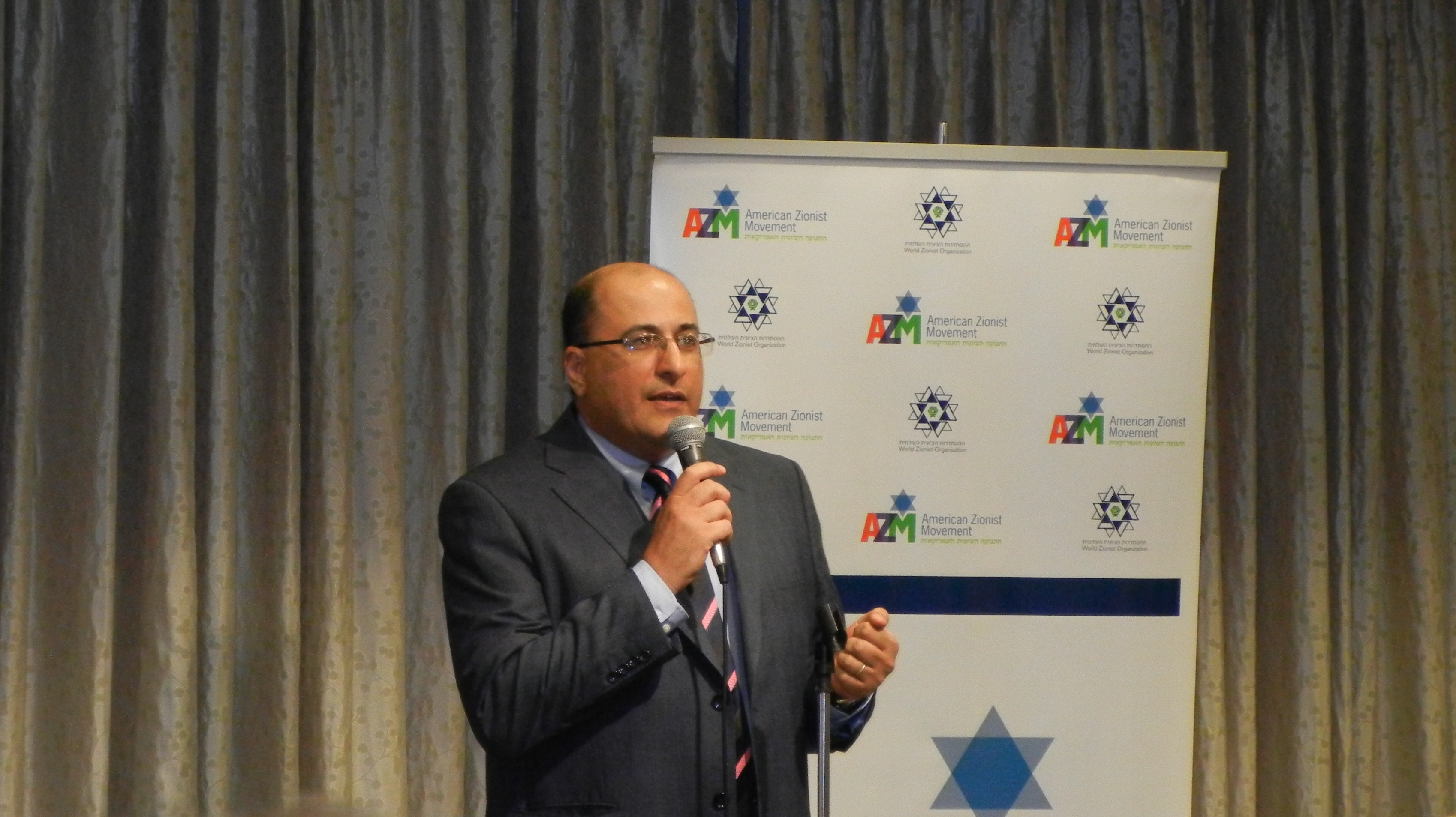 Ambassador Ido Aharoni, the Israeli Consul General to New York, addresses the crowd.