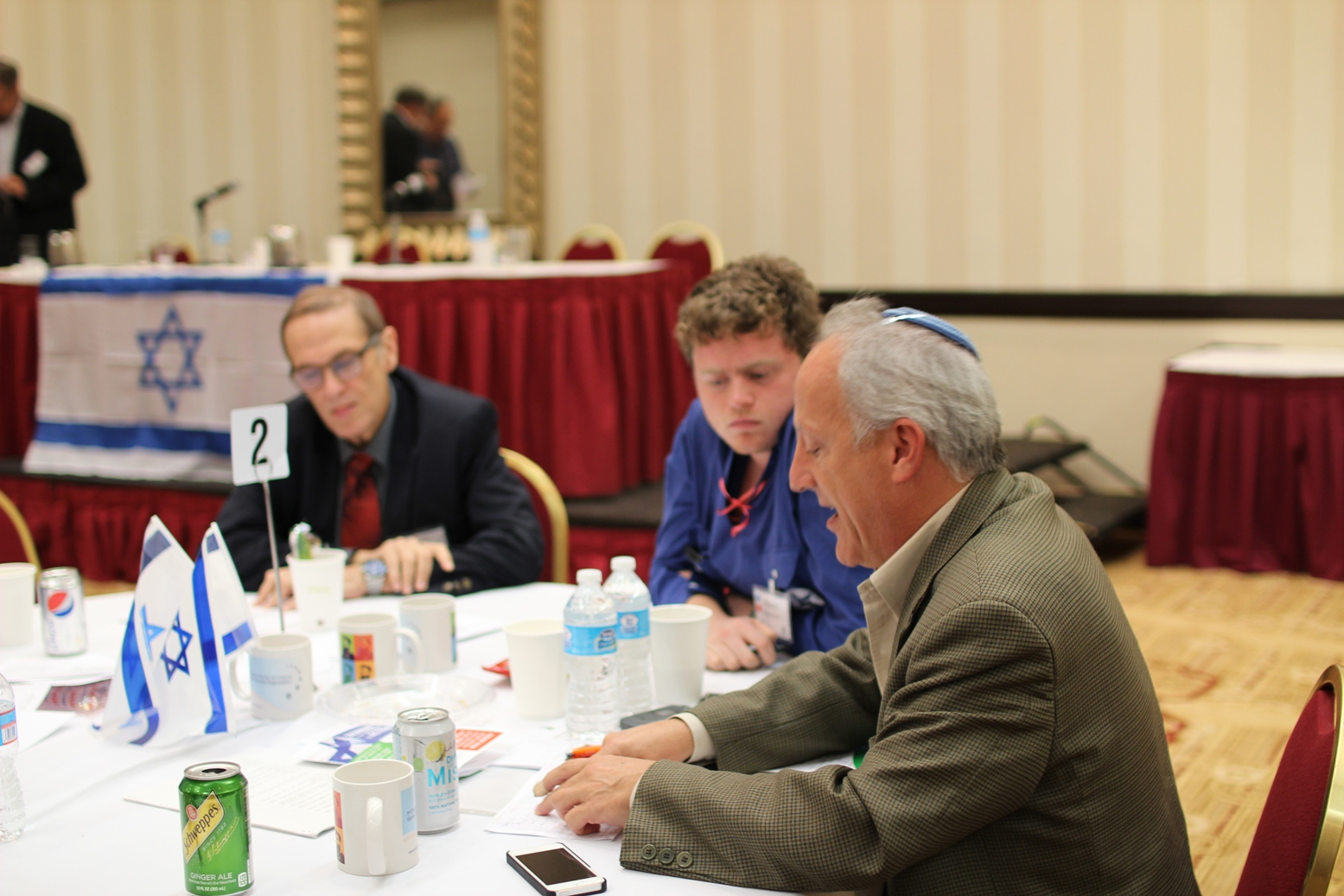 Aryeh Green, director of Media Central, conducts a group discussion