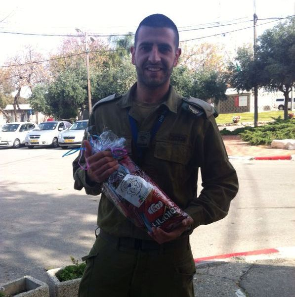 An Israeli soldier shows off his mishloach manot